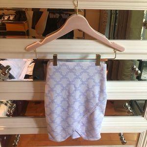 white and purple asymmetrical mini skirt